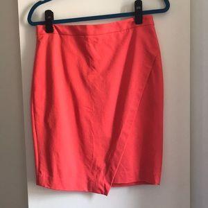 Asymmetrical coral pencil skirt